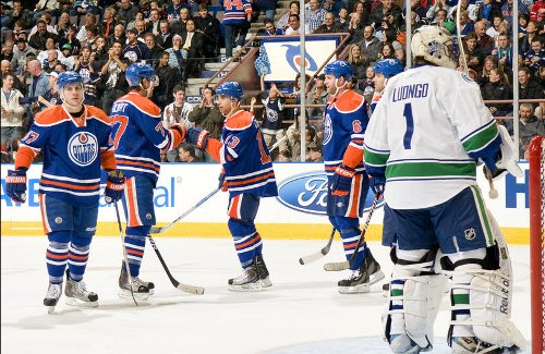 EDMONTON, AB - MARCH 23: Roberto Luongo #1 of the Vancouver Canucks looks on as the Edmonton Oilers celebrate a second-period goal at Rexall Place on March 23, 2010 in Edmonton, Alberta, Canada. (Photo by Andy Devlin/NHLI via Getty Images)