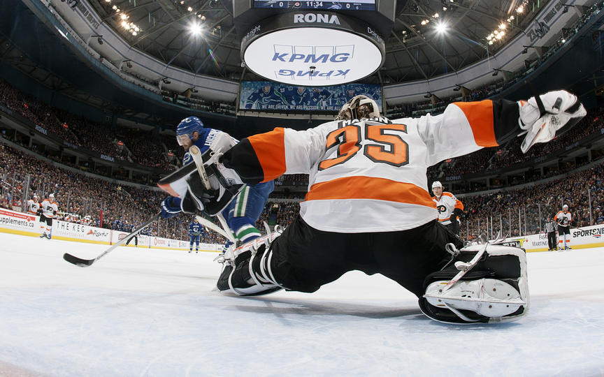 Steve Mason makes a first period save on Chris Higgins.