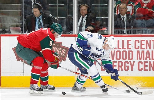 SAINT PAUL, MN - OCTOBER 19: Mikko Koivu #9 of the Minnesota Wild knocks the puck away from Mason Raymond #21 of the Vancouver Canucks during the game at the Xcel Energy Center on October 19, 2010 in Saint Paul, Minnesota. (Photo by Bruce Kluckhohn/NHLI via Getty Images)